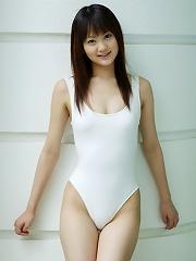 Perfect petite asian hottie shows off her body in a pink bikini
